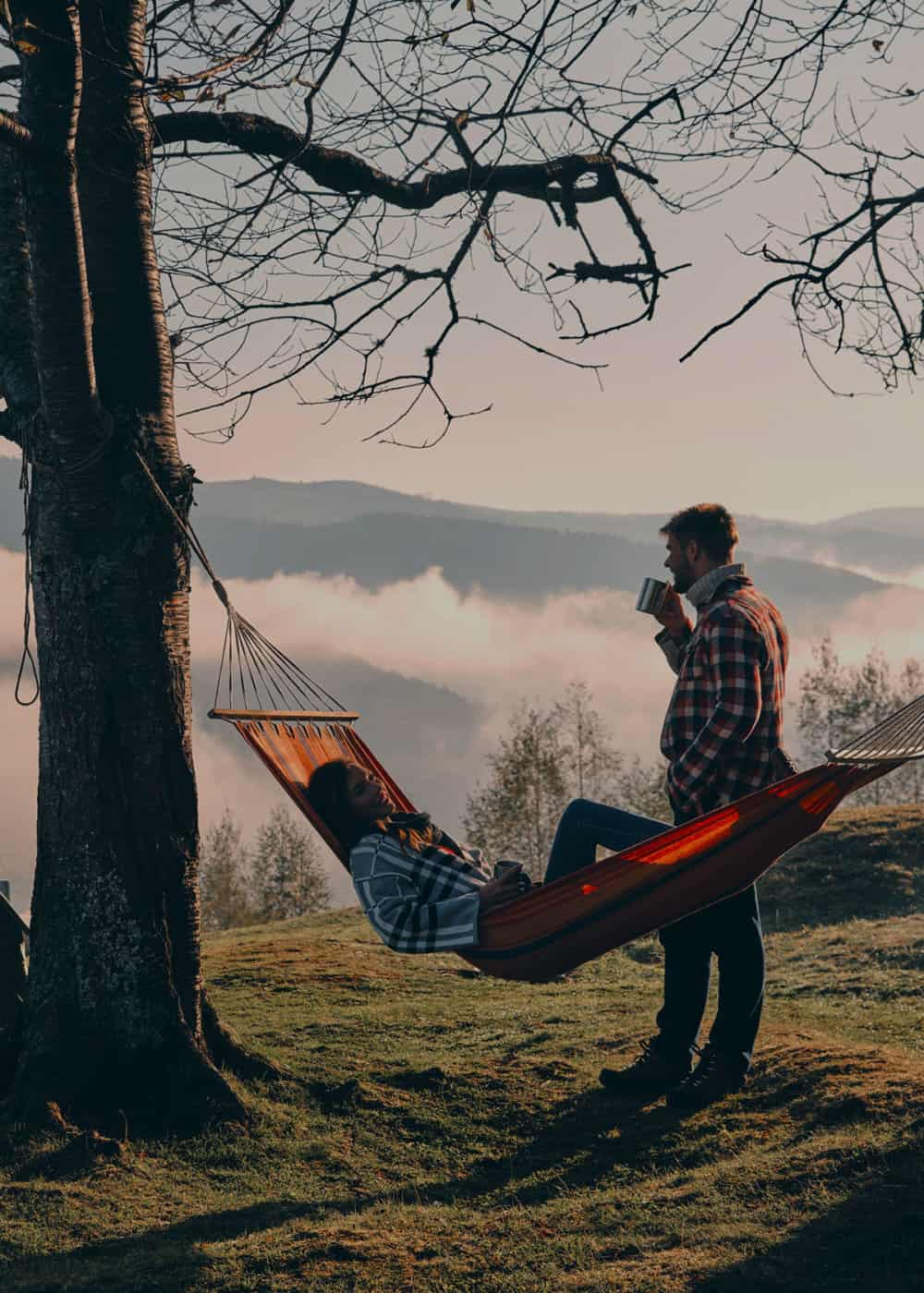 Couple camping with a hammock